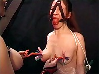 Gagged girl gets her nipples clamped hard
