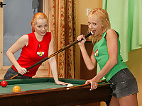 Two teenage girls are shooting pool and the chase each other around the pool table. They end up on top of it and do a little striptease. Wearing only their T-shirts they do some French kissing before giving each other a treat with a vibrator.