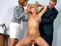 Office sex slave riding a dildo and sucking a toy